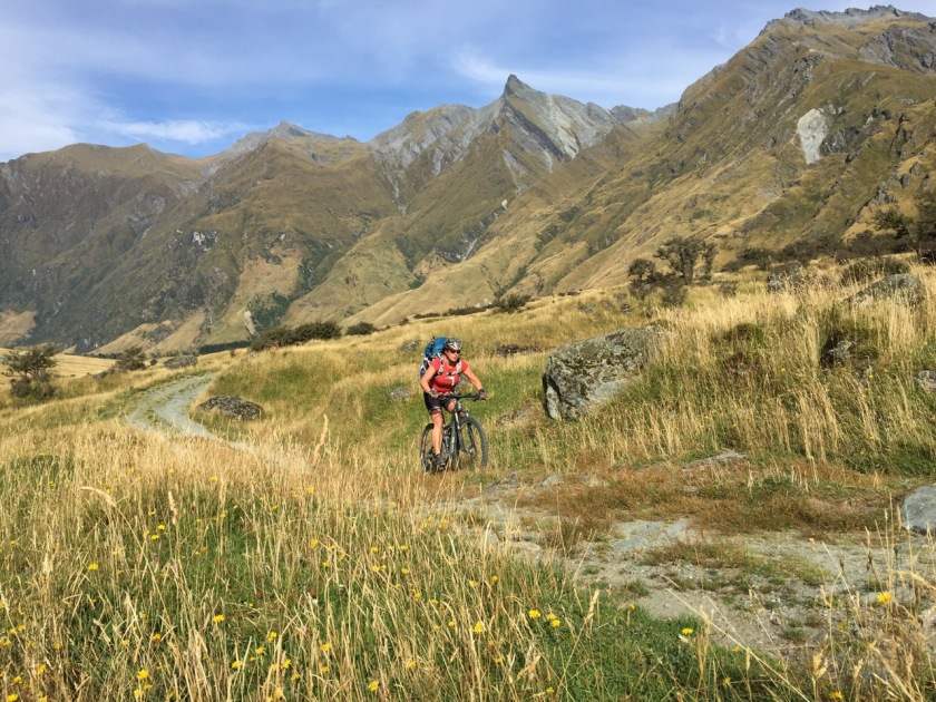 Mountain biking into Mount Aspiring National Park New Zealand
