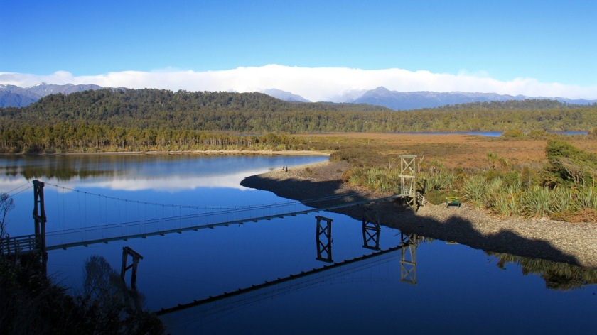 A bridge spans a lagoon on the West Coast of New Zealand