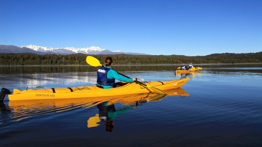 Kayaking on the West Coast of NZ with views of Mount Cook, NZ