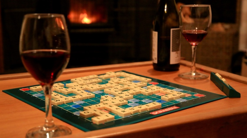 Scrabble and red wine in front of the fire