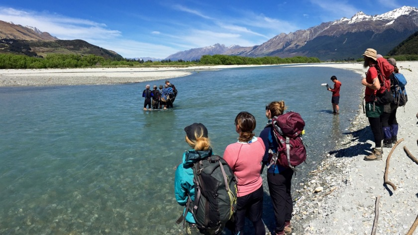 Hikers crossing a river, Glenorchy NZ