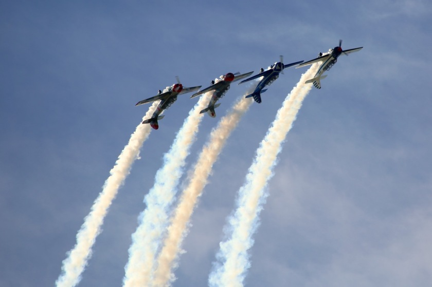 The Yak 52 Aerobatic Display Team perform at Warbirds Over Wanaka Air Show