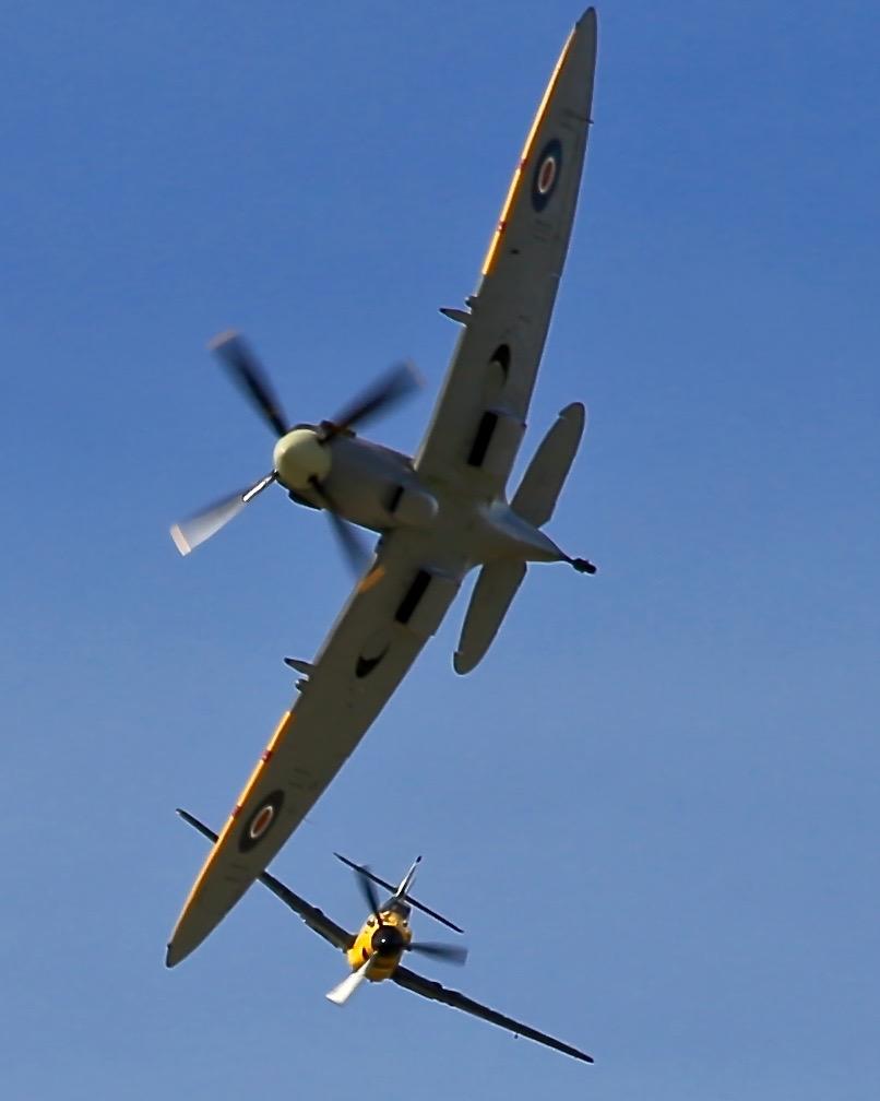 A Spitfire is pursued by the Messerschmitt 109 at Warbirds Over Wanaka Air Show