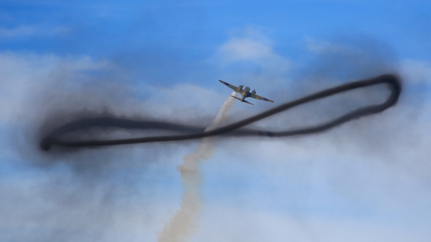 Avro Anson flies through a smoke ring at Warbirds Over Wanaka Air Show