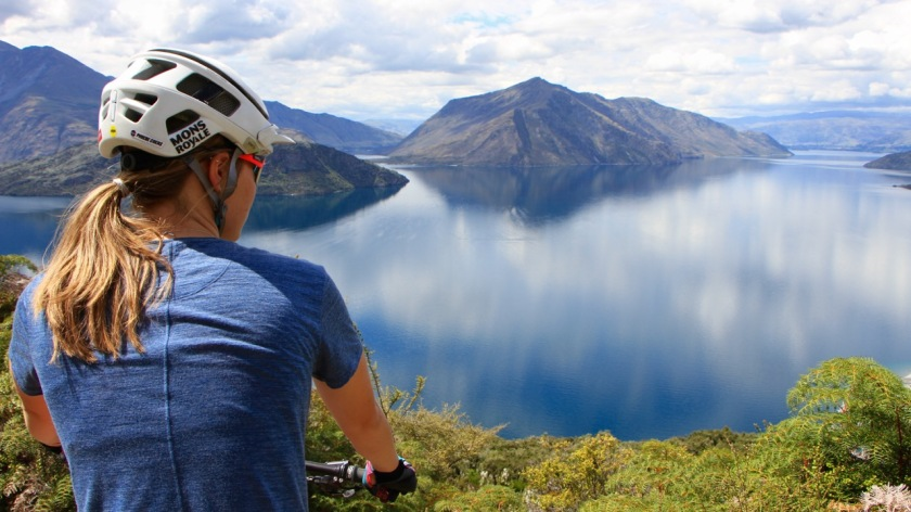 A mountain biker enjoys a view of Lake Wanaka, New Zealand
