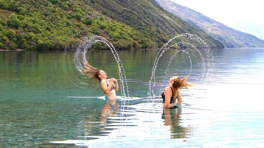 Swimmers have fun in Lake Wanaka, New Zealand