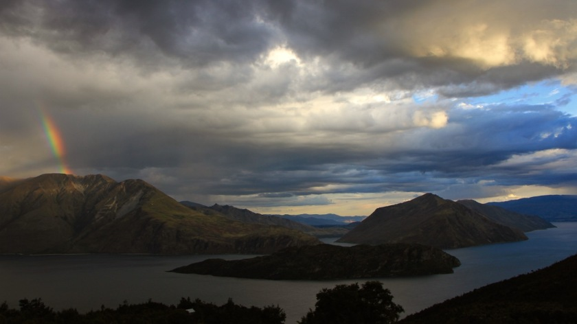 Storm clouds and a rainbow over the mountains, Wanaka New Zealand