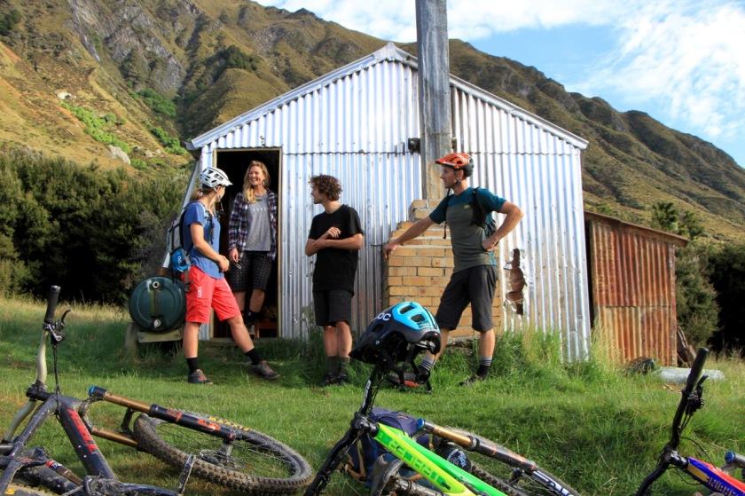 Mountain bikers at a backcountry hut, Lake Wanaka NZ