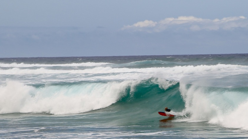 Body boarding on Kaui, Hawaii