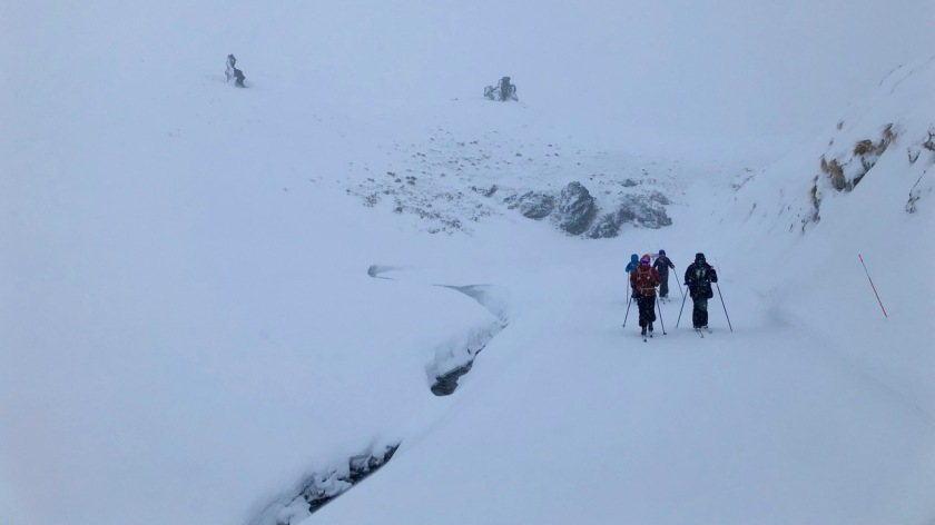 Cross country skiers in a blizzard, Snow Farm Wanaka New Zealand
