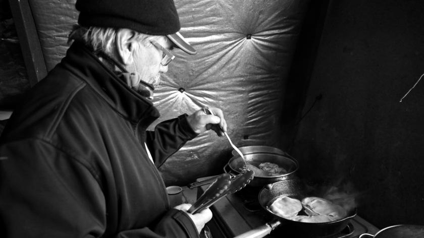 Cooking bacon at Bob Lee Hut, Snow Farm, Wanaka NZ