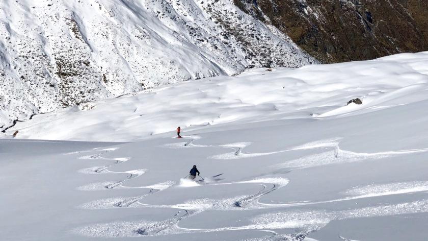 Skiers in fresh snow at Treble Cone, Wanaka, New Zealand