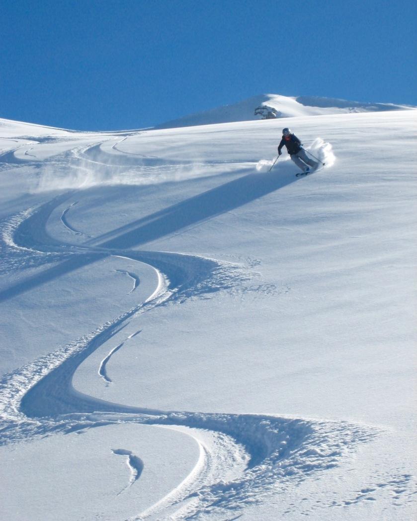 Skier in fresh snow at Treble Cone, Wanaka, New Zealand