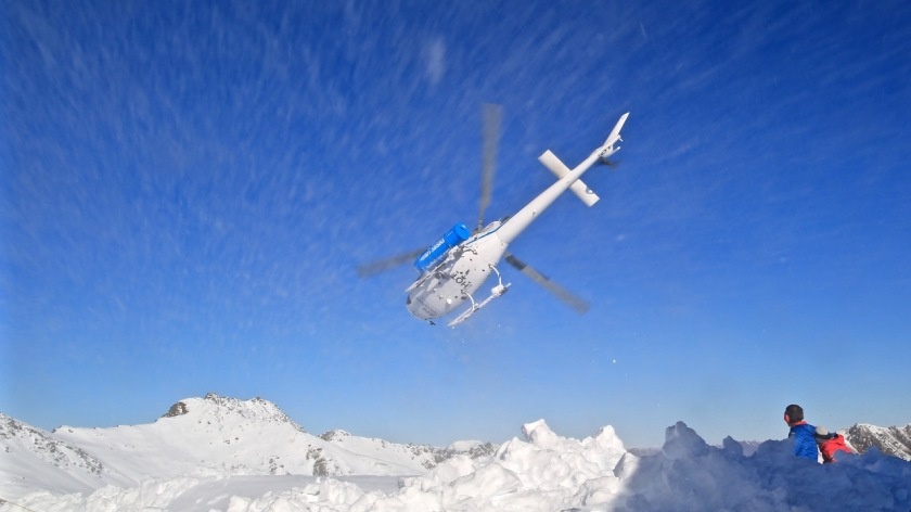 Helicopter take off over the Southern Alps near Wanaka, New Zealand