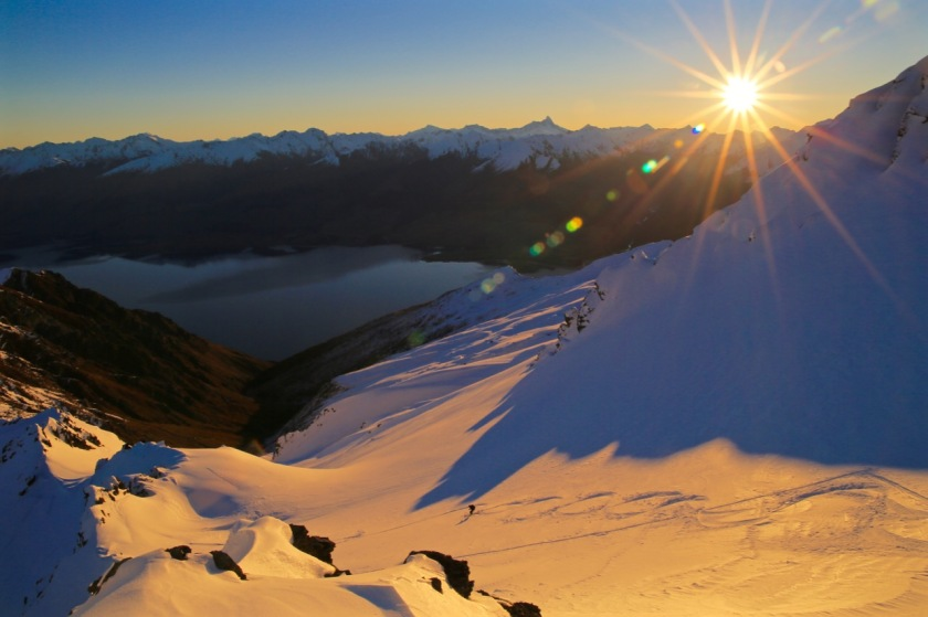 Ski-touring at sunset in the Southern Alps near Wanaka, New Zealand