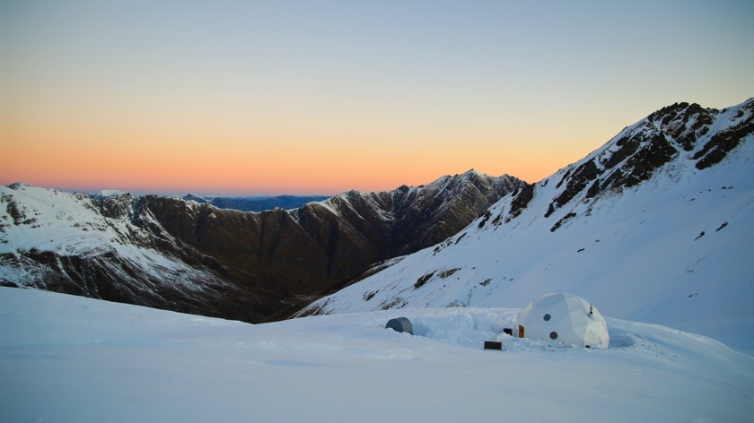Ski-touring camp at sunset in the Southern Alps near Wanaka, New Zealand