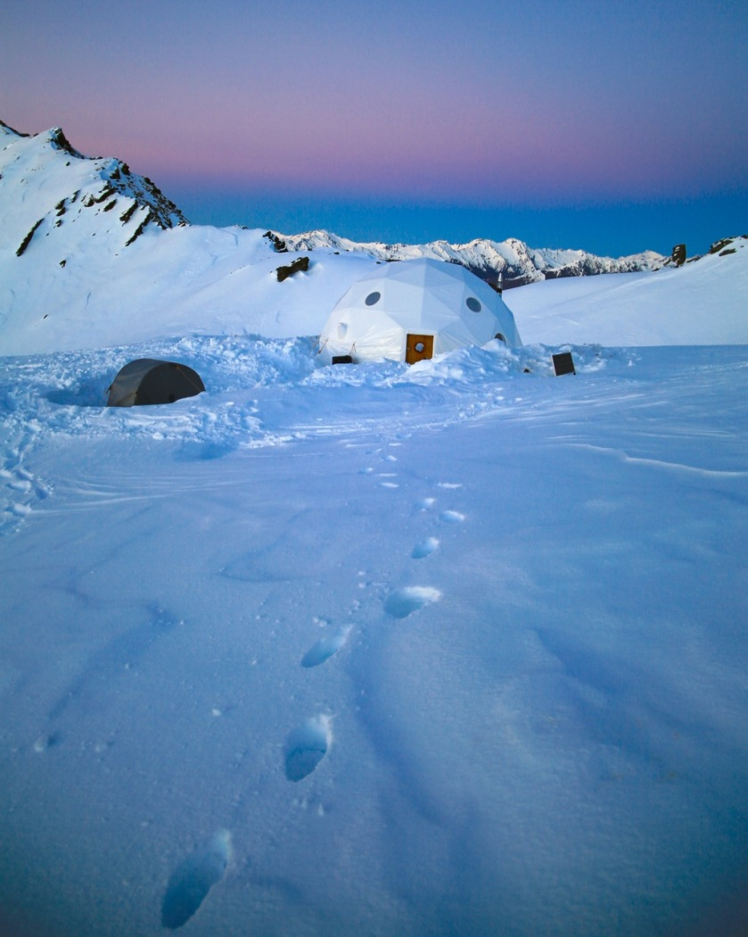 Ski-touring camp at sunrise in the Southern Alps near Wanaka, New Zealand