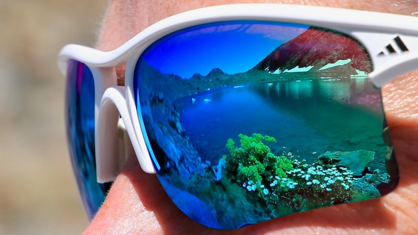 An alpine lake high in the mountains of the Southern Alps, New Zealand reflected in a pair of sunglasses
