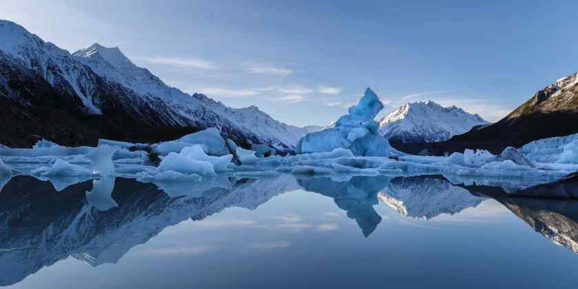 Icebergs reflected in the mirror like waters of the Tasman Glacier Lake.