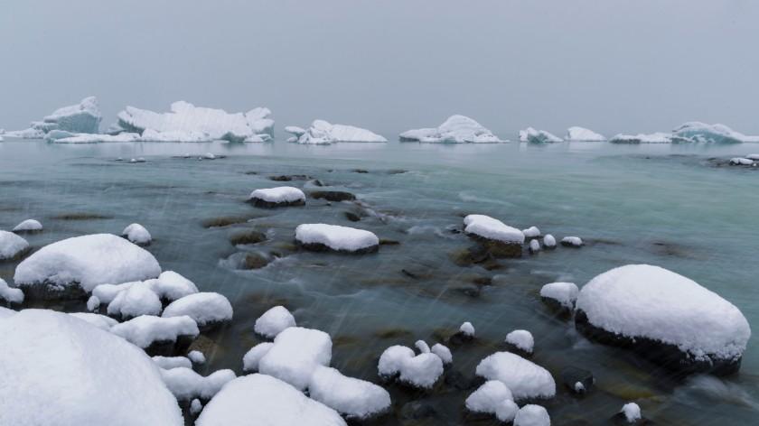 Snow and icebergs Tasman Glacier Lake Mt Cook New Zealand